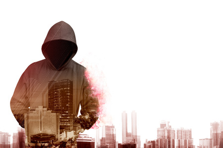 web scam: Man in hoodie shirt is hacker. Computer security concept Stock Photo