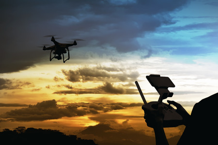 Male pilot controlling drone with remote control Standard-Bild