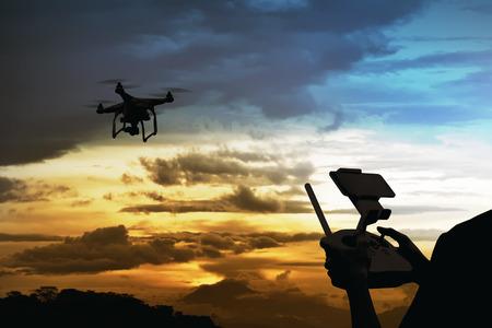 Male pilot controlling drone with remote control Archivio Fotografico
