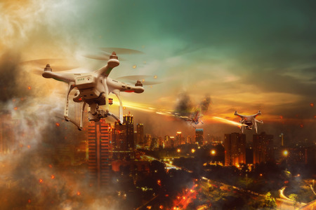 Drones battle over the city at night time Stock Photo
