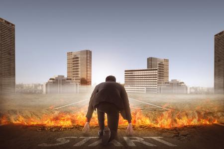 broken back: Back view of asian business man start running over broken road with fire