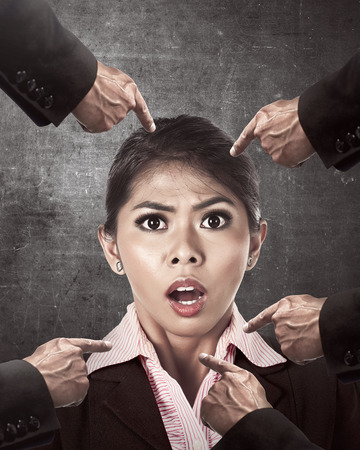 accused: Asian business woman accused by her friend at the office Stock Photo