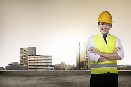 asian architect: Young succesful asian architect over city background Stock Photo