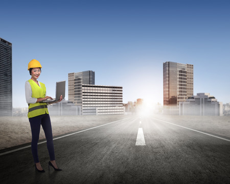 asian architect: Asian woman in safety vest posing. Female architect concept Stock Photo