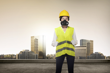 safety vest: Asian woman in safety vest posing. Female architect concept Stock Photo