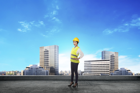 female architect: Asian woman in safety vest posing. Female architect concept Stock Photo