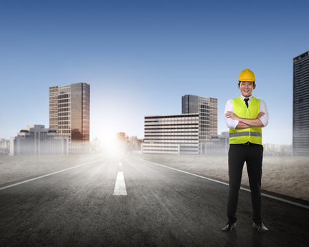asian architect: Asian man in safety vest posing. Male architect concept