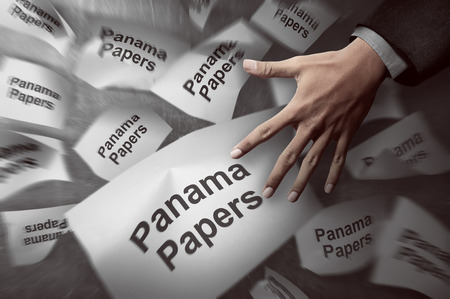 scandal: Image of man hand investigate panama papers scandal