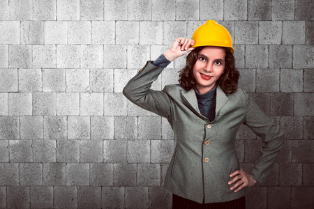 yellow hard hat: Asian woman engineer holding yellow hard hat