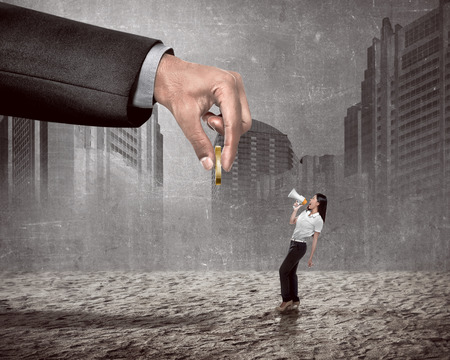 give money: Asian woman speaking with megaphone to big giant hand give money. Say no to corruption Stock Photo