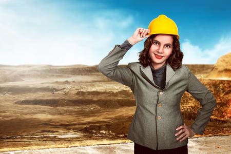 woman engineer: Asian woman engineer holding yellow hard hat