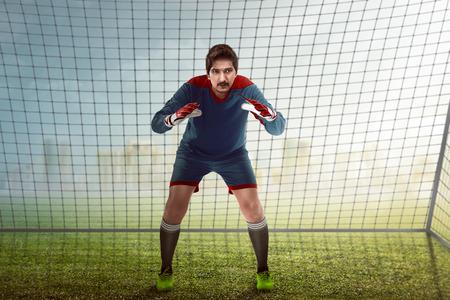 goalkeeper: Image of goalkeeper in front of goalpost