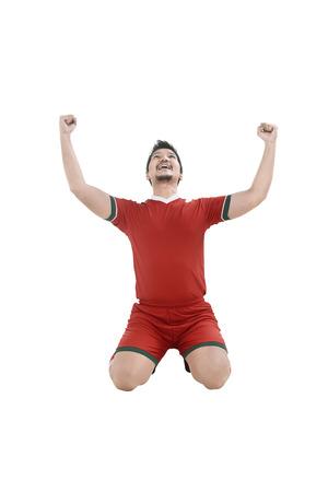 Image of winning football player after scoring