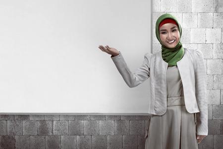 jilbab: Image of muslim business woman show something