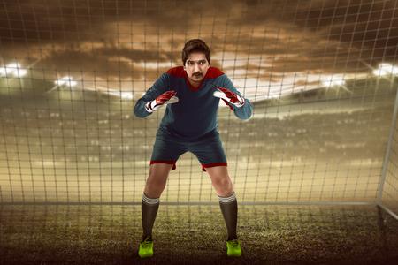 Image of goalkeeper in front of goalpost