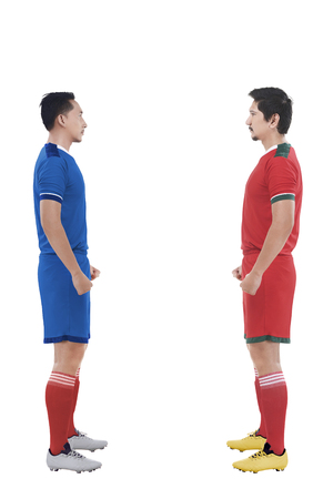 facing each other: Two football player facing each other isolated over white background Stock Photo