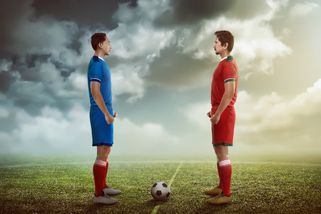 facing each other: Two football player facing each other on the kickoff at the stadium Stock Photo