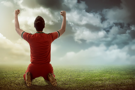 Image of winning football player after score in a match