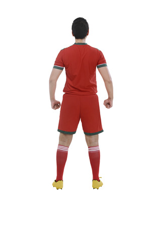 Back view of male soccer player isolated over white background
