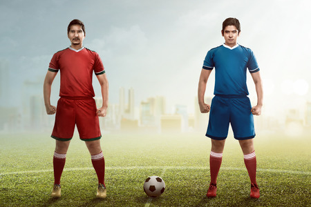 kickoff: Two football player posing on the kickoff at the stadium