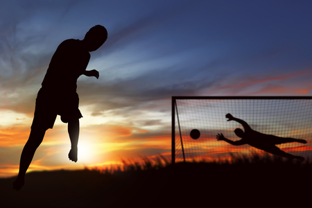 Silhouette of soccer player ready to execute penalty kick on the field