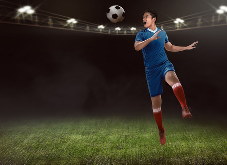 football play: Image of soccer player header on the stadium