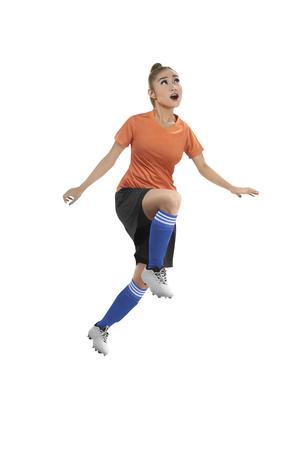 female soccer: Image of female soccer player header isolated over white background