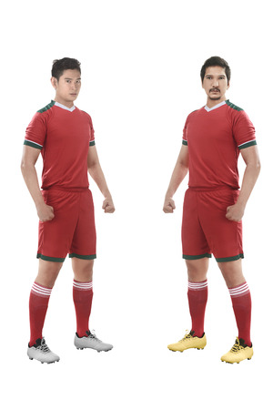 Two asian football player standing isolated over white background