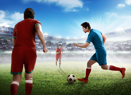 dribbling: Image of football player dribbling ball intercepted by other