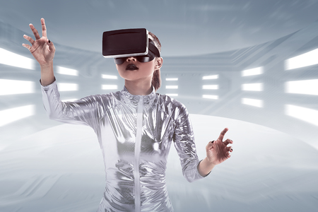 Young pretty asian woman wearing VR headset inside virtual world. Virtual reality concept