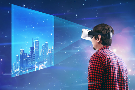 Young asian man wear VR headset get into virtual reality world Stock Photo