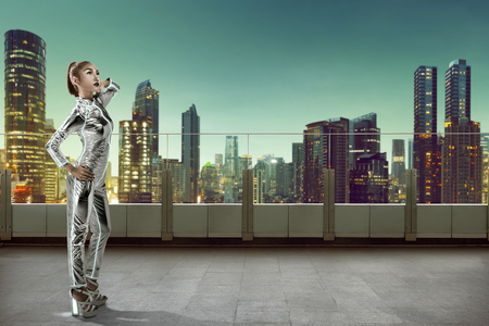jumpsuit: Asian woman wearing latex jumpsuit posing on building rooftop
