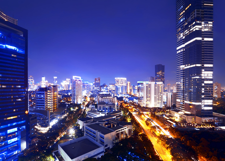 Jakarta city at night with modern building Banque d'images