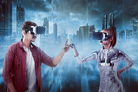 Man and woman touching with finger inside cyber world. Virtual reality concept