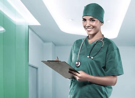 Asian doctor holding medical check up result over hospital background