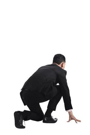 man kneeling: Man kneeling on start position. Businessman ready to start job.