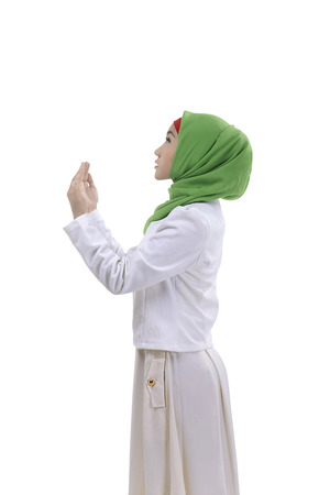 bismillah: Young asian muslim man praying to god, she is pretty with isolated background