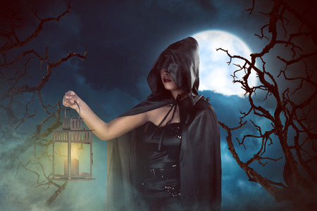 Moonlight lanterns: Asian witch woman holding lantern in the night when fullmoon, horror situation