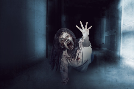 Asian zombie woman, ugly face and anger expression in empty room, horror situation.