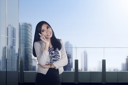 preety: Pretty asian business woman calling with smile expression Stock Photo