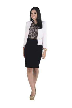 Young and beauty asian business woman, isolated over white background