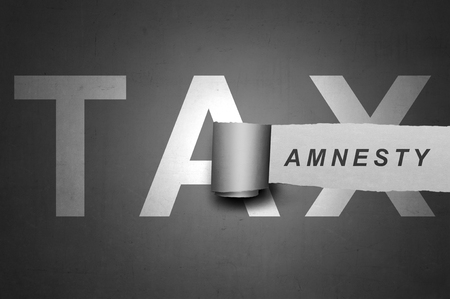 Tax amnesty quotes design on the gray board