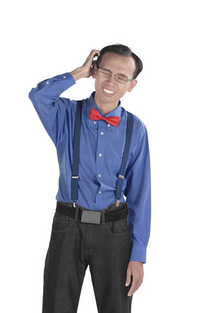 embarassment: Asian nerdy man confused, isolated over white background