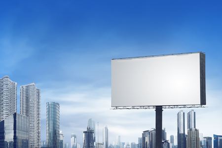 Blank bilboard on the city with building and blue sky background, you can put your design on here Zdjęcie Seryjne
