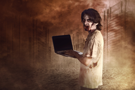 entities: Horrible male zombies standing typing in laptop looking at behind in the dead town