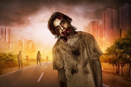 Horrible scary zombie walking around on the burned city Stock Photo