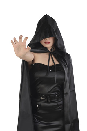 Asian witch woman with black cloak showing catching hand, isolated over white background