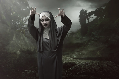 wicked woman: Asian nun woman is considered to have magic powers of evil in the woods