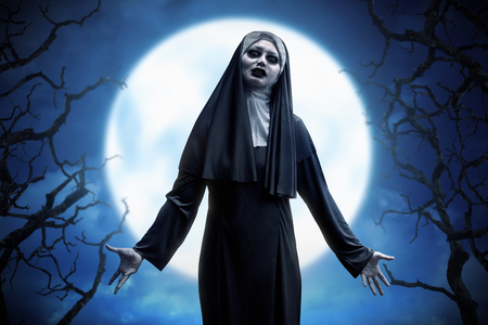 daemon: Scary asian evil nun woman expressions on the moonlight at forest