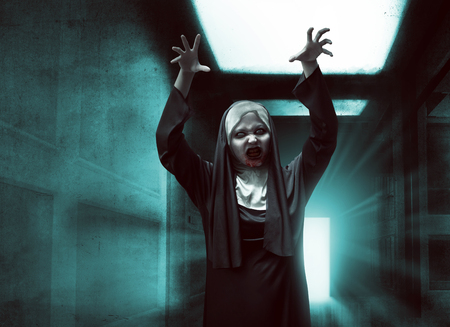 incubus: Scary asian nun with bloody mouth raise up hand want to scare Stock Photo